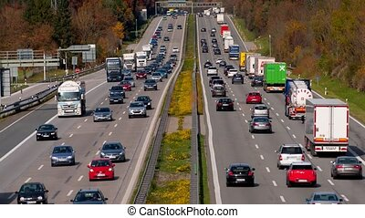 Time lapse of moving cars and trucks on german highway,...