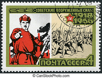 USSR - CIRCA 1968: A stamp printed in USSR shows 1918 poster and marching volunteers, series 50th anniversary of the Armed Forces of the USSR, circa 1968