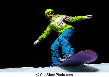 Woman balancing with hands on snowboard