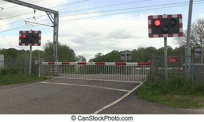 Barrier going up ata level crossing - Diesel train crossing...