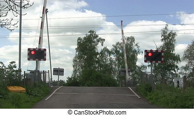 Barrier coming down, level crossing - Amber Orange lights...