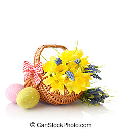 Daffodils and easter eggs - Daffodils in wicker basket and...
