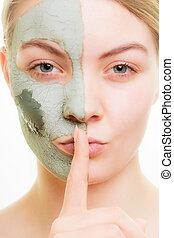 Skin care Woman in clay mud mask on face Beauty - Skin care...