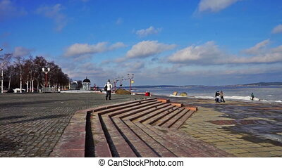 People walking near lake in cold day - PETROZAVODSK, RUSSIA...