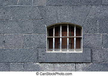 prison cell window - Old prison cell window and wall Concept...