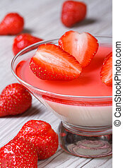 delicious panna cotta in a glass and strawberries. Vertical