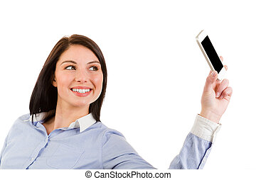 Portrait of young smiling brunette woman taking a self portrait with her phone