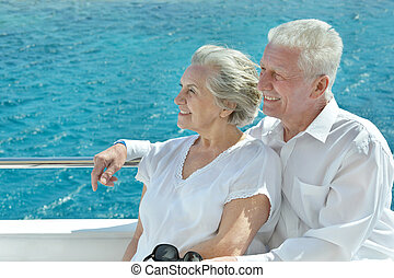 Couple having boat ride - Amusing elderly couple have a ride...