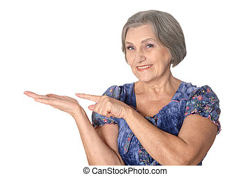 Elderly woman pointing - Senior lady pointing on a white...
