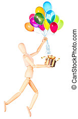 wooden Dummy holding gift and flying balloons - wooden Dummy...