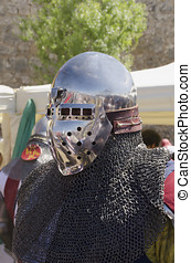 Mail armour - A medieval knight with helmet and mail armour