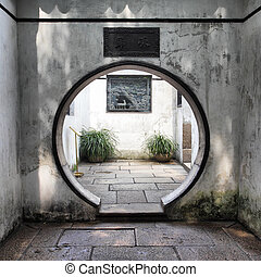 Round doorway in ancient Yu Yuan Garden in Shanghai, China