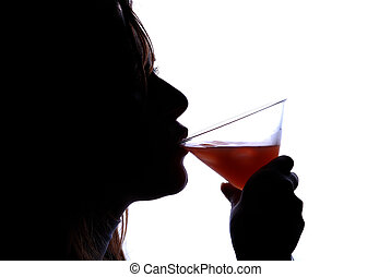 woman drinking cocktail - Silhouette of woman drinking...