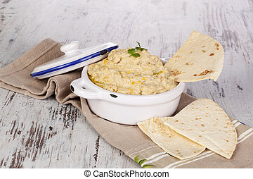 Hummus. - Delicious hummus with pita bread on white wooden...