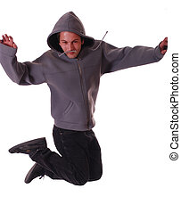 Young male dancer makes a jump