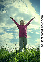 Girl pulls hands to the sky.