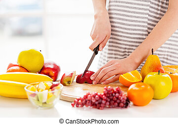 Making a fruit salad. Cropped image of pregnant woman making a fruit salad