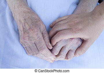 Elderly and young woman hands - Wrinkled hands of an 93...