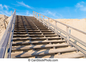 wooden stairs over a sand dune on the 2nd maasvlakte in...