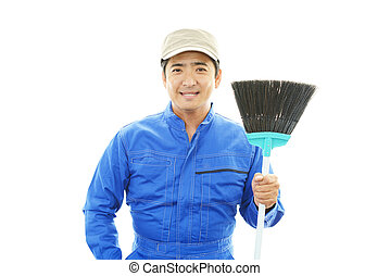 Janitorial cleaning service - The male worker who poses...