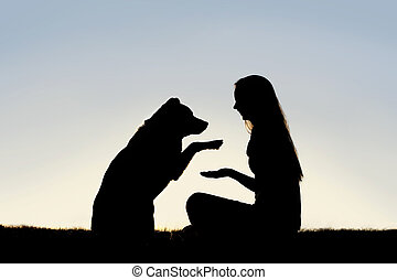 Woman and Her Pet Dog Outside Shaking Hands Silhouette - a...