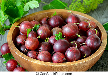 Gooseberries in wooden bowl - Gooseberries in bowl on wooden...