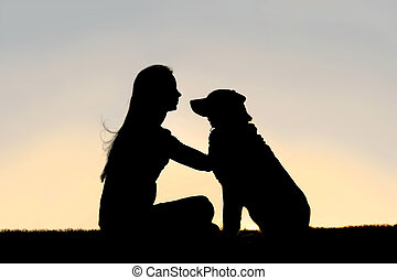 Woman Sitting Outside Petting Dog Silhouette - a special and...