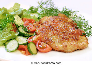 Chicken schnitzel with vegetables and herbs.