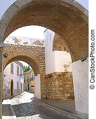Historical Arch - historical arch of the old town of Faro in...