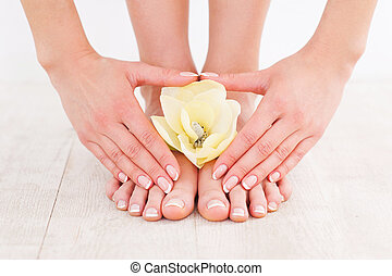 Beautiful manicure and pedicure. Close-up of young woman...