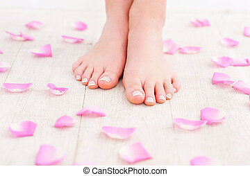 Beautiful feet. Cropped image of beautiful female feet on...