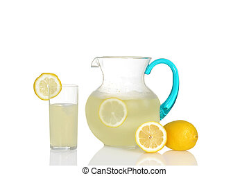 glass of lemonade with pitcher - closeup of glass of...