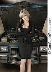 Car breakdown - A frustrated blond female in her 30\'s...