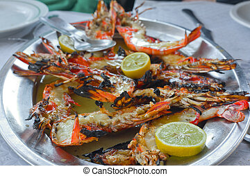 Portuguese grilled seafood - Grilled red shrimps on metal...
