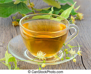 Tea with linden flowers - Cup of herbal tea with linden...