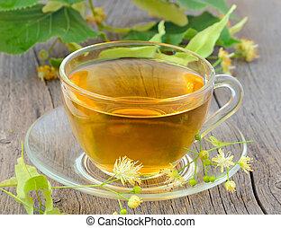Tea with linden flowers - Cup of herbal tea with linden...