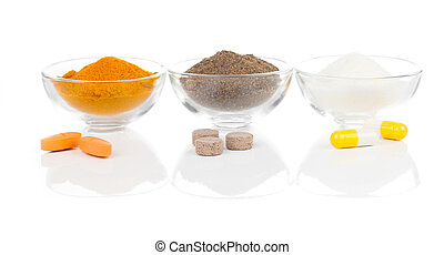 pills and powder on a white background