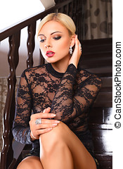 Young woman sitting on steps - Young beautiful blonde woman...