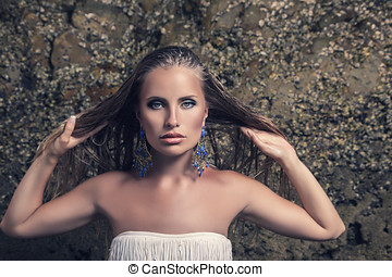 Fashion model with earrings