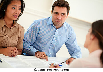Ethnic couple interested in a contract - Portrait of ethnic...