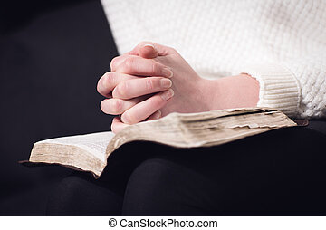 Reading bible and pray - Christian woman pray and folding...