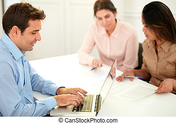 Adult hispanic businessman using his laptop - Portrait of...