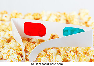 3D glasses with popcorn on white background