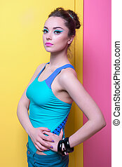 Girl in bright clothes, colored background