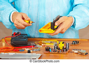 Hands service engineer of electronic equipment in service...