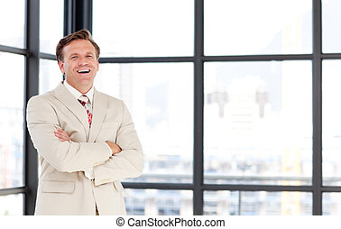 Smiling senior businessman with folded arms - Senior...