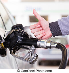 Petrol being pumped into a motor vehicle car - Petrol or...