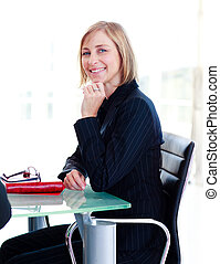 Businesswoman sitting in a meeting