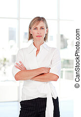 Serious businesswoman with folded arms - Serious mature...