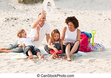 Family playing with the sand